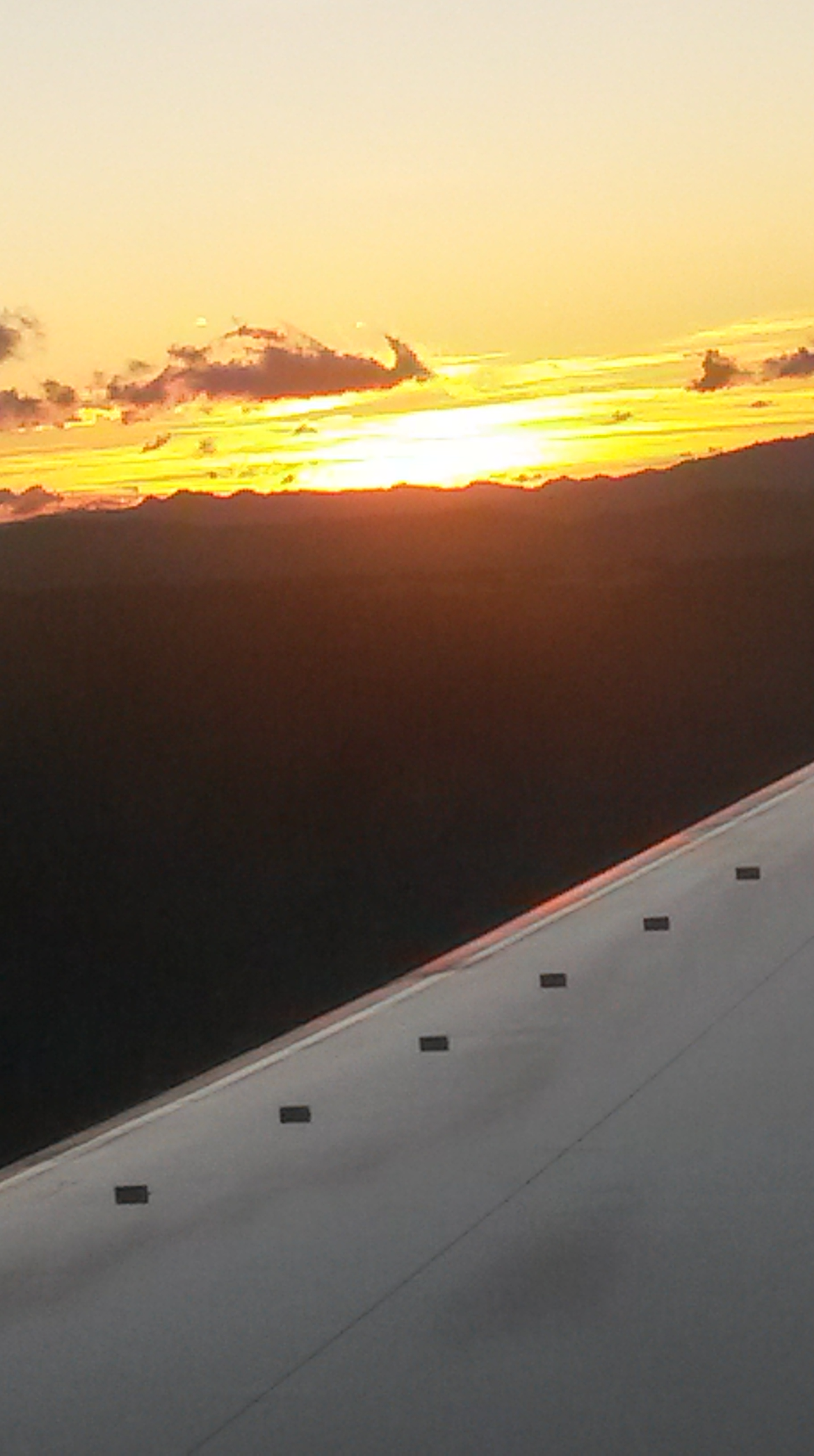 Sunrise over Guatemala City as we touch down at 6 a.m.