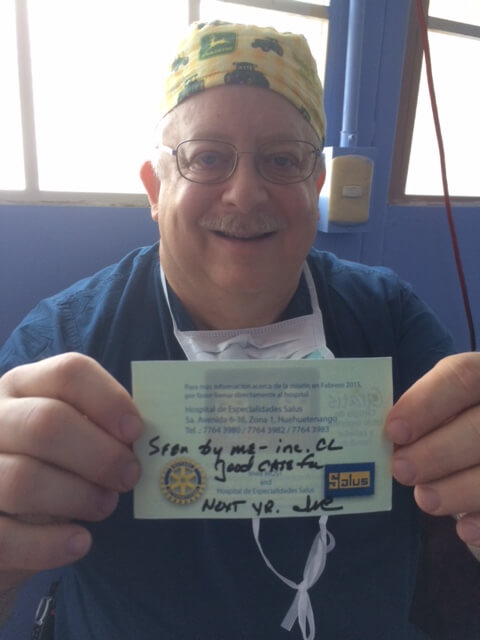 "Dr. John holds up the card he wrote one year ago, assuring Pablo's mother he was a ""good case for next year."""